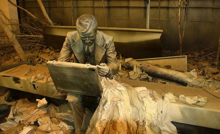 sculpture of dazed businessman on bench