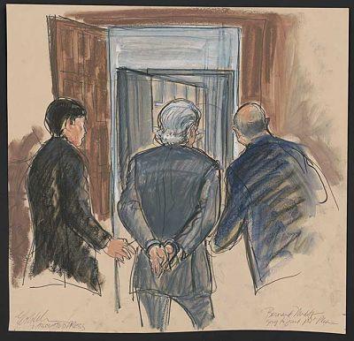 Bernie-Madoff-led-off-in-handcuffs