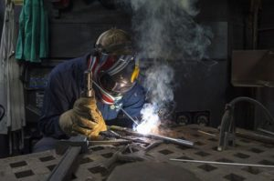 Welder in shop