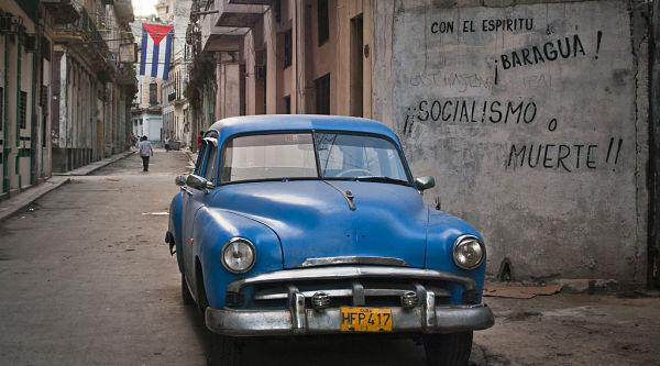 Car by 'socialism or death' grafitto