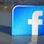 Facebook logo in sand