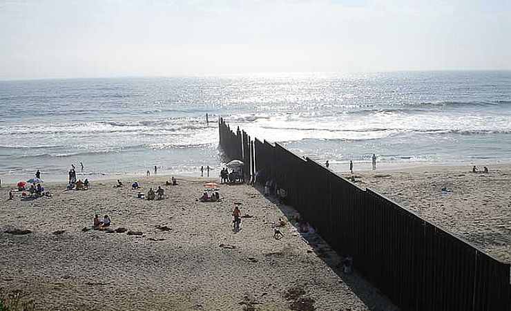 Fence bisects border beach