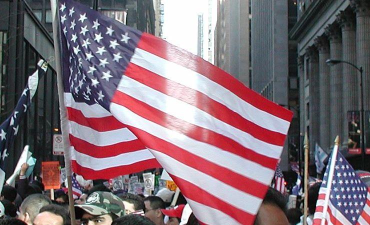 Light shines through American flag