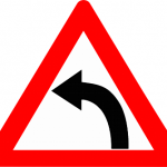 Left_hand_curve_sign_(India)_opt