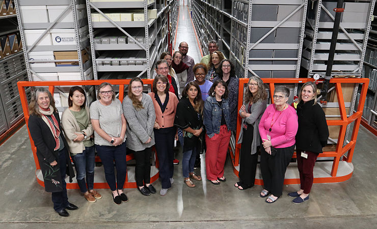 Fellows and staff in library warehouse