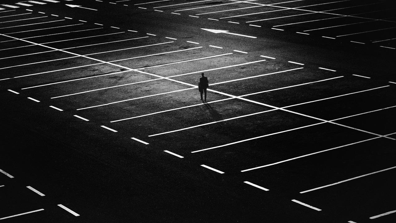 Solo figure in parking lot