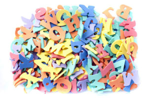 a pile of rendom coloured letters on a white background