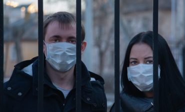Couple wearing facemasks