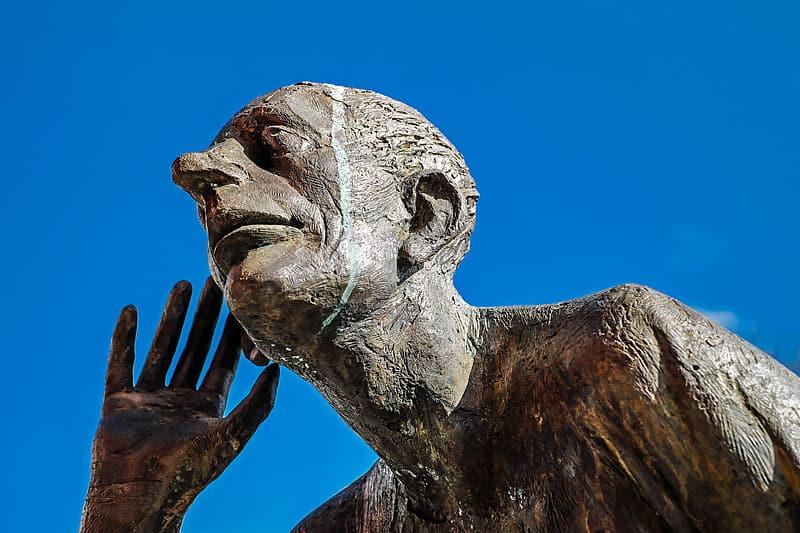 man listening statue